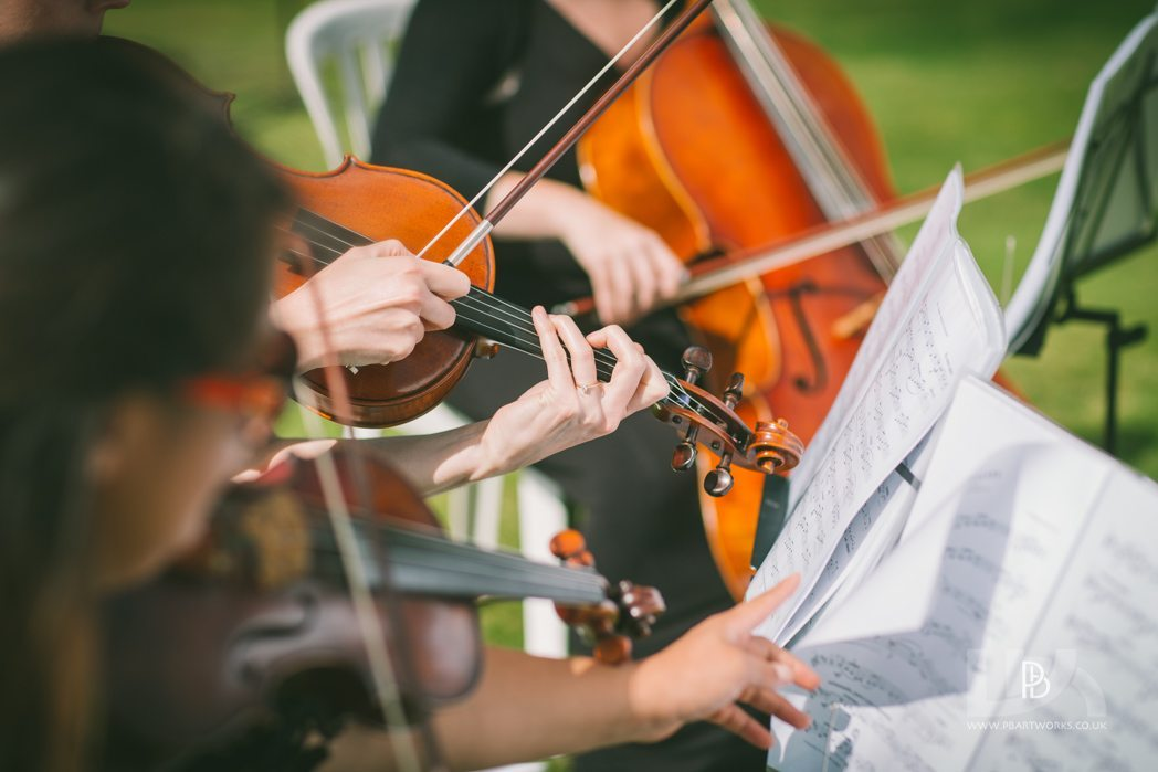 A quartet playing in the gardens for a civil ceremony in Shrewsbury