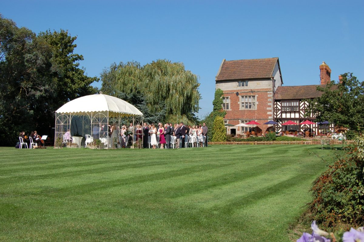 Shropshire wedding venue with an out side Civil Ceremony on the front lawns at the Albright Hussey Manor