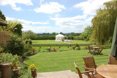 Garden view of the shropshire hills from the Albright Hussey Manor